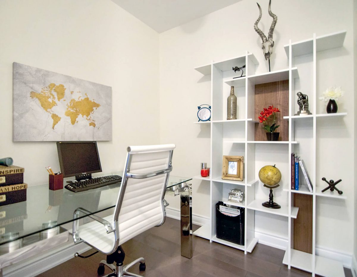 Glass desk with white office chair and white bookshelf