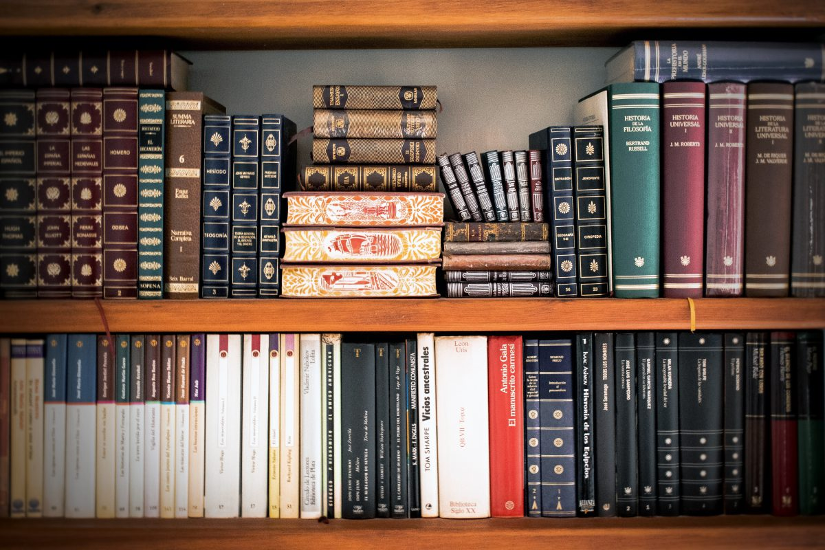 A bookshelf full of leather law books.