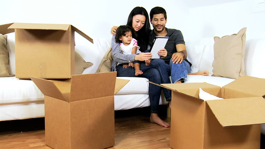 Moving as a family with boxes at home